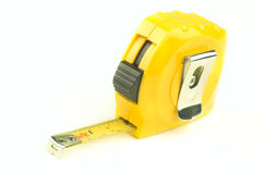 Tape Measure. A yellow plastic tape measure on a white background Royalty Free Stock Photography