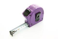 Tape measure. Purple tape measure Royalty Free Stock Photo