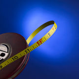 Tape measure. Against a blue background Royalty Free Stock Images
