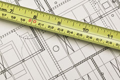 Tape measure against blueprints Stock Photography