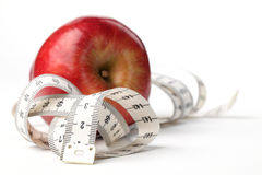 Tape measure and apple Stock Images