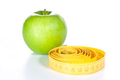 Tape measure and apple royalty free stock photo