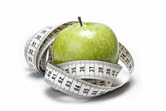 Tape measure and apple. Royalty Free Stock Photos