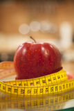 Tape measure and apple. Royalty Free Stock Photo
