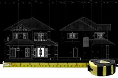 Tape Measure and architectural drawing Royalty Free Stock Images