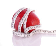 Tape measure around  apple Royalty Free Stock Image
