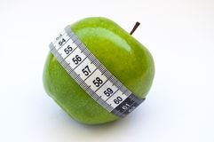 Tape measure around apple Stock Images