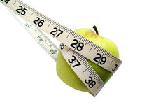 Tape measure around apple Stock Image
