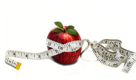 Tape measure around an apple Stock Images