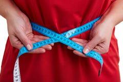 Tape measure around belly Stock Image