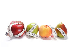 Tape Measure Around Fruits Stock Image