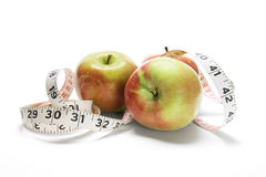 Tape Measure Around Fuji Apples Stock Photography