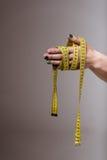 Tape measure around hand Royalty Free Stock Photo