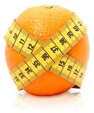 Tape measure around orange royalty free stock image