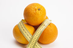 Tape measure around oranges Royalty Free Stock Photography