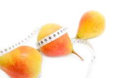 Tape measure around pears Royalty Free Stock Image