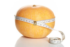 Tape measure around pumpkin Royalty Free Stock Image