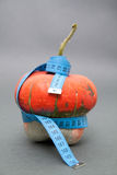 TAPE MEASURE AROUND PUMPKIN Stock Images