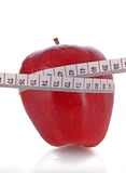 tape measure around a red apple Stock Photos