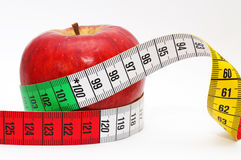 Tape measure around red apple Stock Images