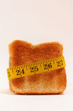 Tape measure around toast Stock Images