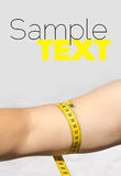 Tape measure around woman's upper arm Royalty Free Stock Image
