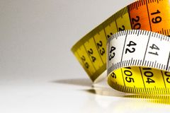 A tape measure as used by people who make their own clothes. Stock Photo