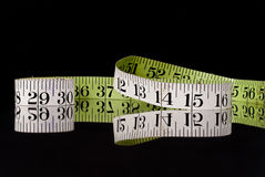 Tape Measure on Black Royalty Free Stock Photos