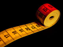Tape measure black background Stock Photography