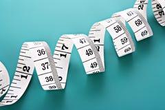 Tape Measure on blue Stock Photos