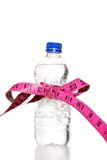 Tape Measure Bow On Water Bottle Royalty Free Stock Photos
