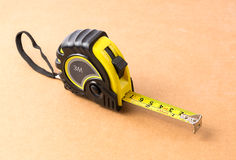 Tape Measure. On a brown background Stock Images