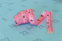 Tape measure on a calendar Royalty Free Stock Photography