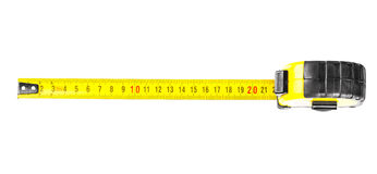 Tape measure in centimeters. Yellow tape measure in centimeters with black numerals stock image