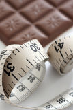 Tape measure and chocolate bar Stock Image
