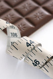 Tape measure and chocolate bar Royalty Free Stock Photo