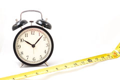 Tape measure with clock in isolated. Tape measure with clock in white isolated Stock Image
