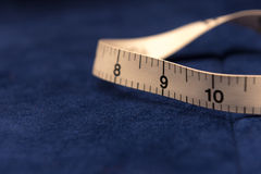 Tape Measure and Cloth Stock Images