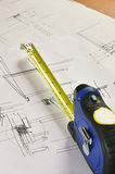 Tape measure and construction plan Stock Photo