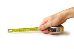 Tape-measure in der Hand Stockfoto