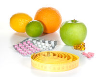 Tape Measure, Diet Pills And Fruits Royalty Free Stock Image
