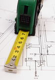 Tape measure on electrical construction drawing of house Stock Photo