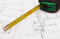 Tape measure on electrical construction drawing of house Royalty Free Stock Photo