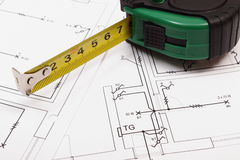 Tape measure on electrical construction drawing of house Royalty Free Stock Image