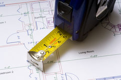 Tape Measure on Floor Plans. A tape measure on construction or architectural floor plans, measuring or planning Stock Photos