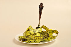 Tape measure and a fork Royalty Free Stock Images