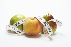 Tape Measure and Fruits Stock Image