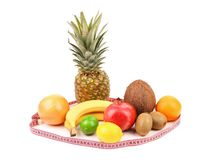 Tape measure and fruits composition. Royalty Free Stock Photos
