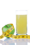 Tape measure with glass of juice and green apple Stock Photos