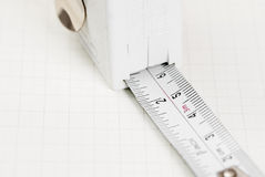 Tape Measure on Graph Paper. Stock Photography